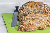 Bread and knife on a green cutting board