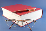 Book, pen and glasses