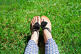 feet in green grass