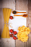 uncooked pasta with tomatoes and spices