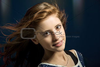 Studio portrait of young beautiful girl