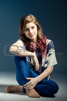 sitting fashion portrait of young beautiful girl