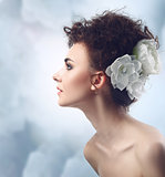 Fashion Beauty Model Girl with Flowers Hair. Bride.