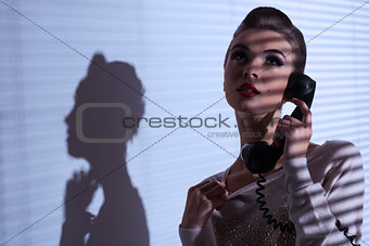 sexy elegant girl talking on phone
