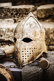 Protective helmet with a visor on medieval knight