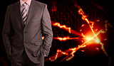 Businessman in a suit and glow rays