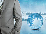 Businessman with background of Earth and graphics