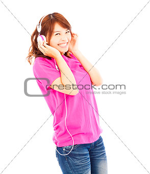 Portrait of young woman listening to music with headphones