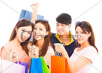 group of happy young people with shopping bags