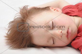 European kid sleeping 3 years old portrait