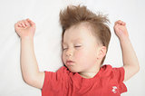 Kid sleeping, arms outstretched