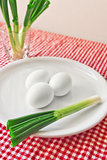 Boiled chicken eggs and fresh spring onion for breakfast