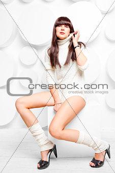 beautiful girl in a warm sweater in studio
