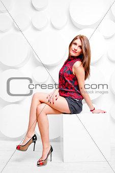 beautiful smiling girl posing sitting