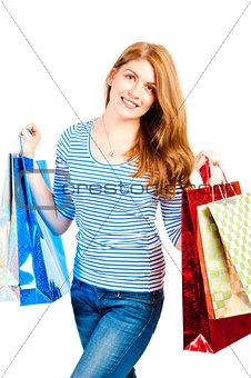 beautiful woman enjoys shopping, studio shot
