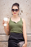 attractive young woman with smartphone and sunglasses outdoor