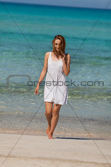 beautiful happy woman on the beach lifestyle summertime