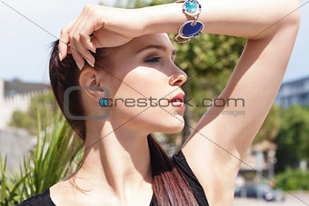 attractive brunette young woman in summer outdoor