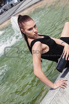 attractive brunette young woman in summer outdoor