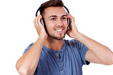 young attractive man listening to music isolated portrait