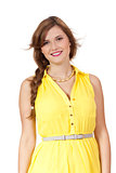 smiling young brunette woman in yellow dress isolated