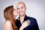 young attractive couple in love embracing portrait
