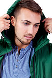 young adult man with green jacket portrait isolated