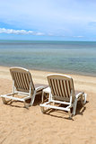 beach chairs on the sea