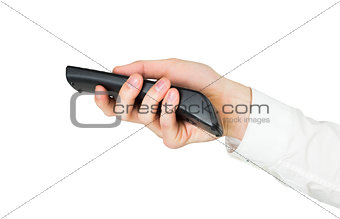 Businessman holding black remote control