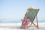 Woman sitting on beach in deck chair