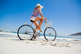 Pretty blonde on a bike ride at the beach