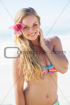 Gorgeous blonde in bikini smiling at camera