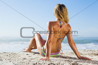 Gorgeous blonde in bikini lying on the beach