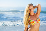 Gorgeous blonde in bikini standing on the beach