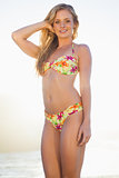Gorgeous blonde in floral bikini smiling at camera