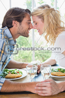 Cute affectionate couple having a meal together