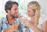 Cute smiling couple enjoying white wine together