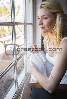 Pretty blonde looking out the window