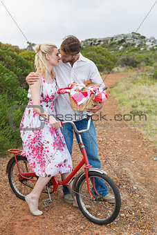 Cute couple going for a picnic kissing each other