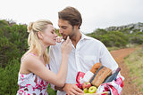Cute couple going for a picnic about to kiss