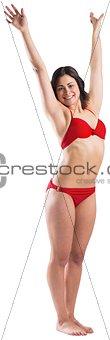 Fit brunette in red bikini posing