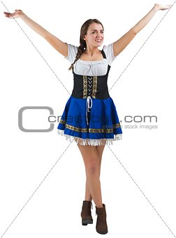 Pretty oktoberfest girl smiling with arms raised
