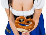 Oktoberfest girl bending and showing pretzel
