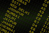 Black airport departures board for india