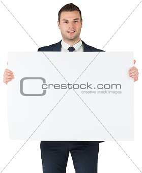 Smiling businessman showing large card