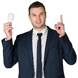 Businessman holding light bulb and pointing