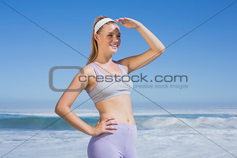 Sporty smiling blonde on the beach