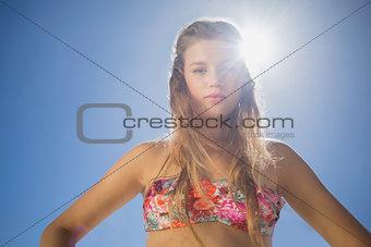 Beautiful blonde in floral bikini on the beach