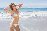 Beautiful fit woman in white bikini on the beach