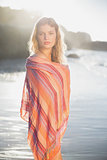 Beautiful blonde wrapped in scarf at the beach